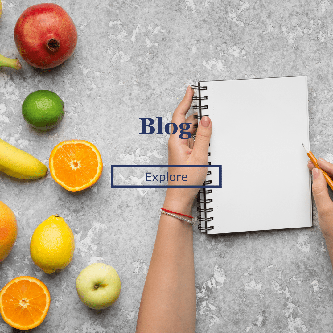 writing a nutrition blog in the kitchen with fruit in the picture