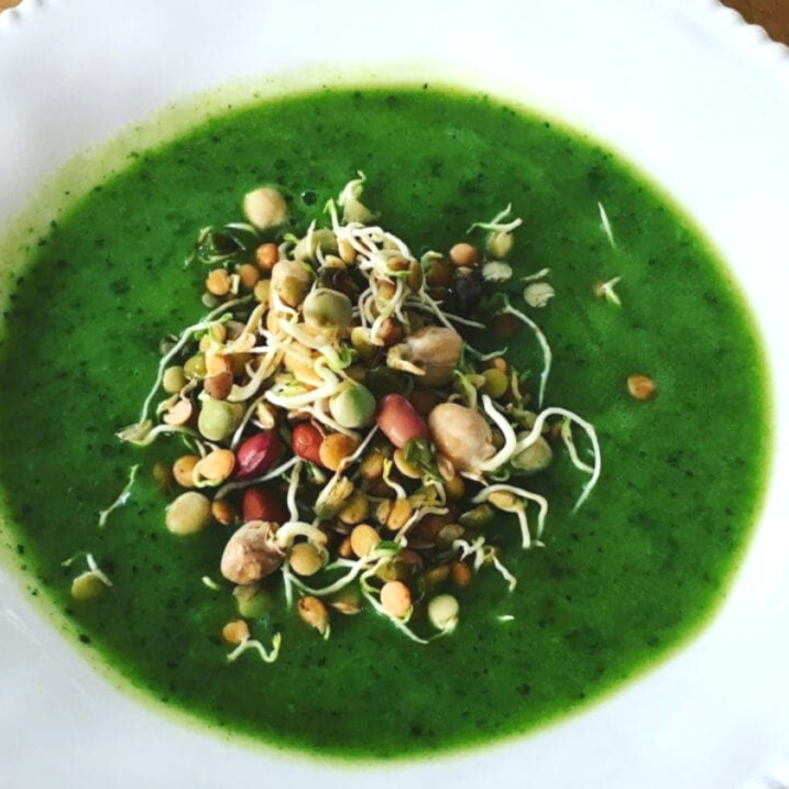 Broccoli almond soup topped with sprouts